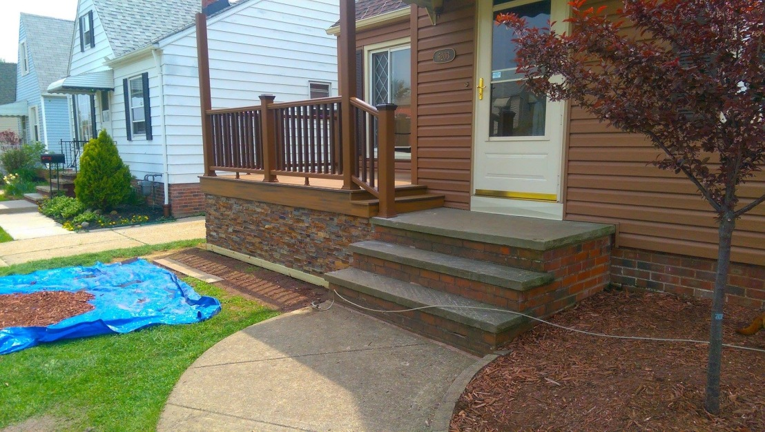 Composite Deck Porch with composite rails and stone trim